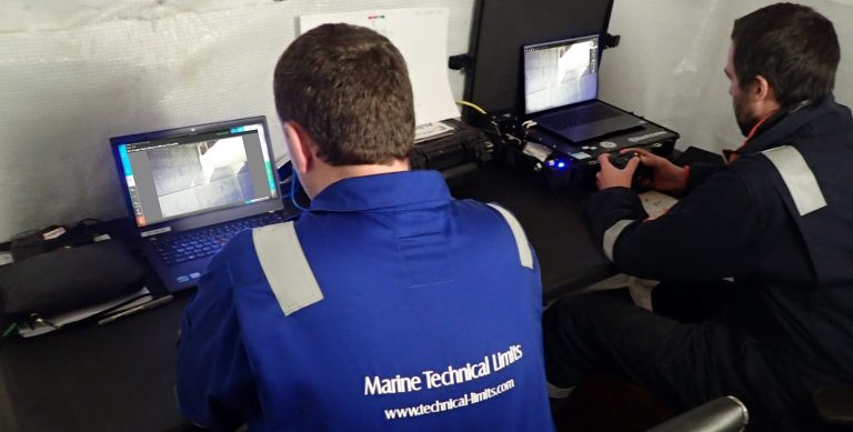 A naval architect and ROV pilot view live camera footage while carrying out an ROV water ballast tank inspection.